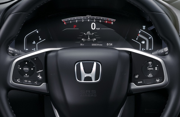 Close-up on a steering wheel and dashboard display inside a 2020 Honda CR-V.