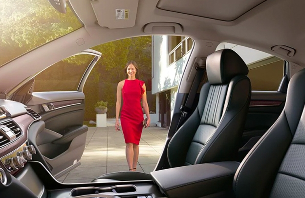 A woman in a red dress approaches the open door of a 2020 Honda Accord