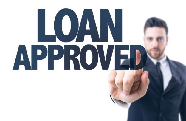 "A man points at large text that reads, ""LOAN APPROVED"""