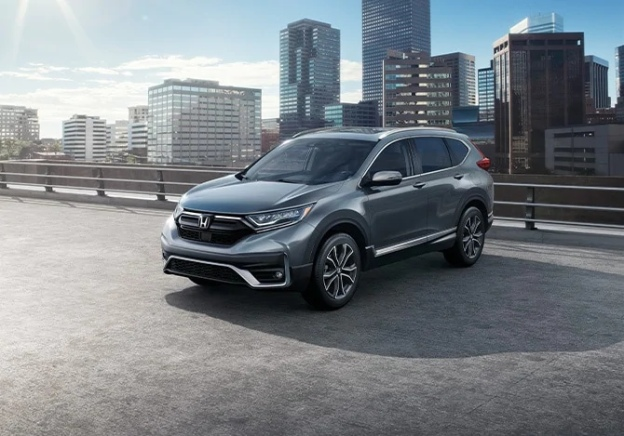 Silver 2020 Honda CR-V in front of a city