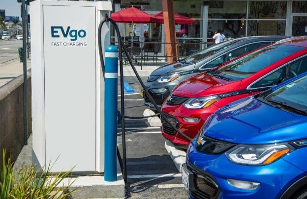 Several vehicles charge at an EVGO charging station