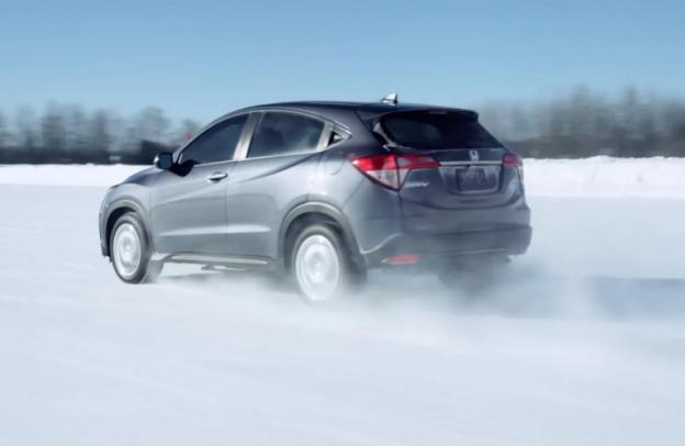 Silver 2021 Honda HR-V cruises through snow