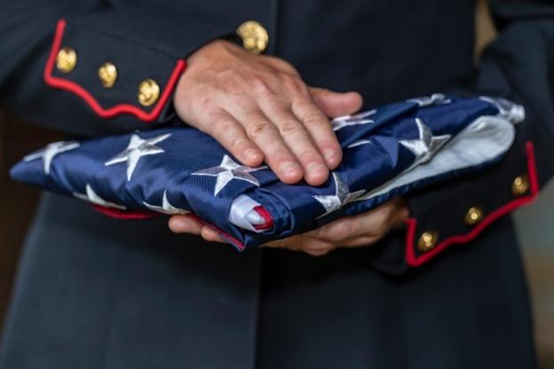 Hands hold flag