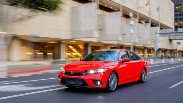 A red 2022 Honda Civic Sedan Touring on the road